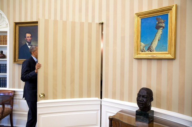 barack_obama_framed_by_a_bust_of_martin_luther_king_jr-_and_a_painting_of_abraham_lincoln